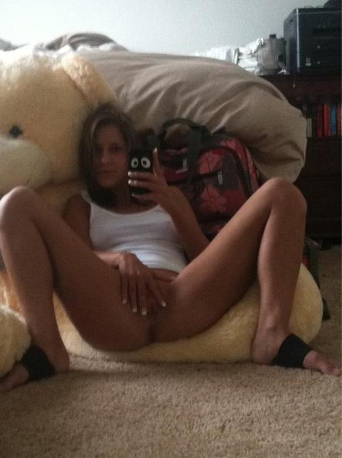 Slim nude teen with gigant teddy bear selfshot spreading pussy 2