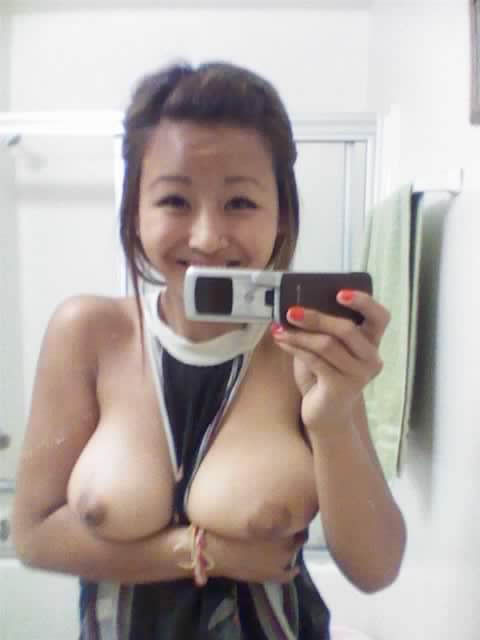 She's having so much fun showing off her huge sexy asian tits
