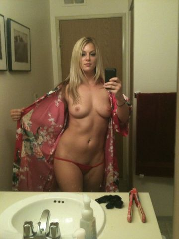 Slim blonde girl in thog exposing small tits in mirror