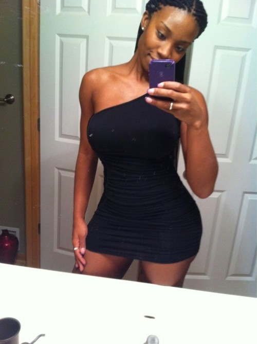 Beautiful black girl in sexy black dress selfshot